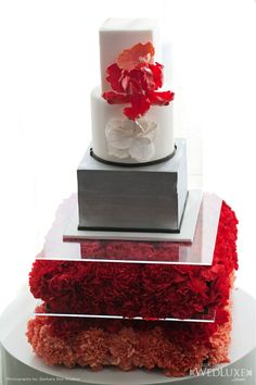Bring Back Carnations - in large amounts, bunched together, they pack a great punch of colour, especially for flower balls (as bouquets, centrepieces, hanging decorations--the possibilities are endless!). Here, they make great floral layers to highlight the wedding cake.