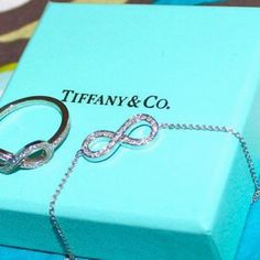 Tiffany & Co. Infinity ring and necklace