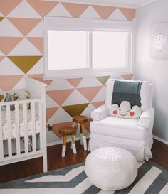 modern hip baby girl nursery, walls by mur nursery focal wall, 'Be Brave' owl print, white Moroccan pouf