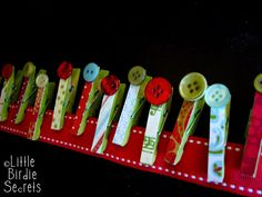 Ribbon and clothes pins. Love the button on the clothespin idea.