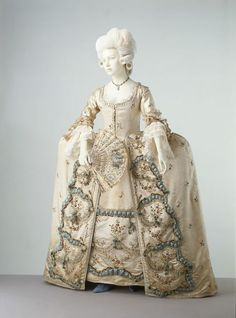 Formal robe à la française, silk satin embroidered with chenille thread lined with silk and linen and trimmed with silk ribbon, bobbin lace, satin, feathers and raffia tassels, 1775-80, probably French.