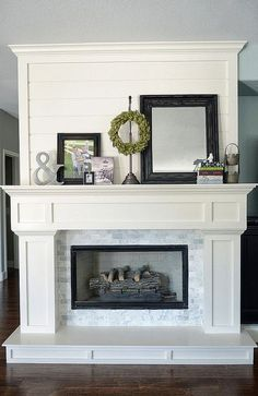 Beautiful fireplace using moulding and small subway tiles. So pretty! I would do just from the mantel and below.
