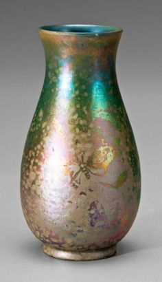 Massier French art pottery vase. Baluster form with butterflies in iridescent luster glaze.