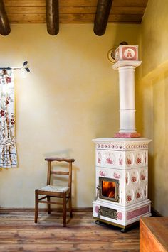 OK, it's not old but new and looks kinda old - the oh so beautiful Voluta tiled stove from the Italian master craftsmen at La Castellamante.
