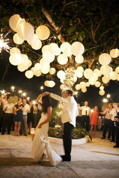 love the hanging lanterns over the dance floor. outdoor wedding.