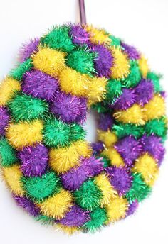 Mardi Gras Wreath made from sparkly pom pom puffs!