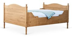 This timeless and versatile bed features beautifully curved lines and intricate wood detailing in a natural finish. It is artisan-crafted using traditional mortise and tenon joinery, and finished...
