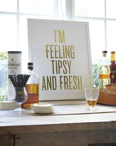 holiday parties, basement bars, art prints, bar cart styling, framed art, bar carts, home bars, framed prints, bar signs
