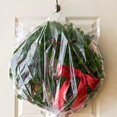 Use dry cleaner bag and hanger to store wreaths.  Brilliant!