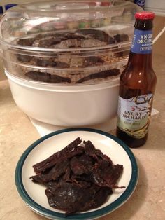"""Angry Orchard Jerky. Recipe for slow cooked venison (substitute for dehydrator):    1 lb of beef or venison cut into 1/8"""" thick strips  2 12 oz bottles of Angry Orchard Crisp Apple  3 Tsp brown sugar  3 Tbsp Liquid Smoke  1/4 cup Worcestershire Sauce  1/4 cup Soy Sauce  2 Tsp Garlic Powder  2 Tsp Onion Powder"""