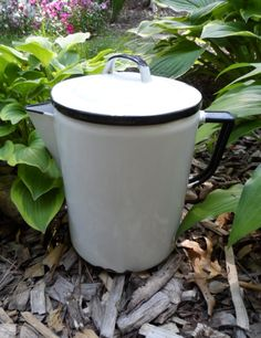 "Vintage 1940's White with Black Trim Enamel Stove top Graniteware Coffee Pot.  This white coffee pot measures 8"" Tall from the base to the rim of the pot and is 5 3/4"" Wide in circumference at its opening.  $27.50 Free Shipping"