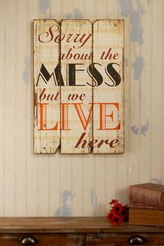 We Live Here - Sign.