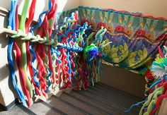 There's no reason to leave stairwells out of the decorating fun!  At Weird Animals VBS we used our extra pool noodle vines to add some excitement to the stairs!  Our fabric, cloth backdrop covers HUGE spaces and tons of fun, bright colors to any dull space! (available for purchase at www.groupvbs.com)