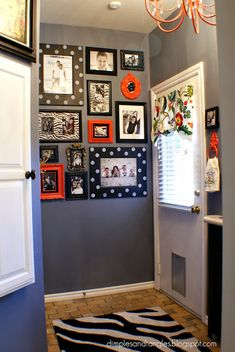 Cute picture gallery - like the splash of coral with the black frames and LOVE the wall color! Idea for front entry?