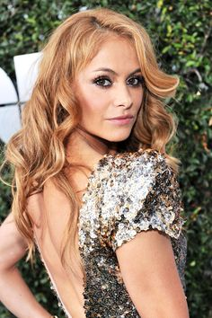 """She's Latin America's """"chica dorada,"""" with tawny skin and gilded ringlets to match. And now, thanks to a star-making turn on The X Factor, singer Paulina Rubio is on her way to earning the golden-girl title here in the U.S."""