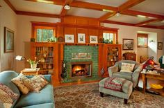 Swedish inspired Newly Built Craftsman Style Home. The mantelshelf extends over built-in bookcases, creating display space for a pottery collection. Original sketches are by eccentric local artist Joe Knowles (1869–1942).