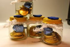 Handmade Hanukkah / Baby Food Jar Project: Dreidel Game Sets! | Would be sweet to do this in a printed fabric bag too.