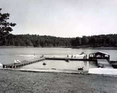 Swimming and boat rides to waterski were popular activities at Old Hickory Resort. A person waterskiing can be seen in the background.