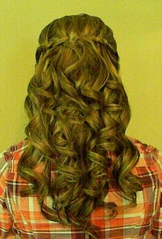 This is me! My hair for prom this year....waterfall braided half updo with lots and lots of curls! =)