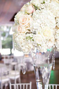 White, floral wedding centerpiece. M. Elizabeth Events