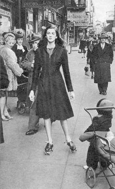 Carmen Dell'Orefice roller-skating to her next modelling job, 1947    Photo by Leonard McCombe.