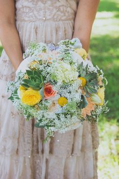 Roses, craspedia balls, succulents, hydrangeas, and baby's breath - we're obsessed with this #weddingbouquet!