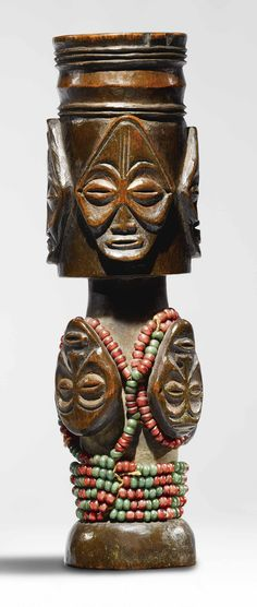 Africa | Double tobacco mortar from the Chokwe people of Angola |  Wood and glass beads