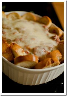 Meatball Sandwich Casserole. Crunchy baguette slices with cheesy meatballs baked in the oven...YUM.