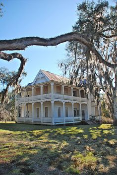 Gorgeous Southern House. Love the porches..