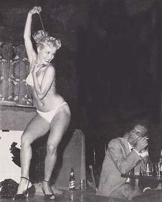 Strip tease artist Tinker Bell on stage, 1950s.