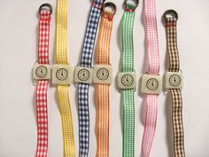 Retro toy watch bracelet. One-of-a-kind handmade fake clock with Gingham watchband. via Etsy.