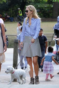 Suki Waterhouse dresses up neutrals by wearing a Banana Republic leather mini and striped button-down.
