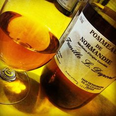 Pommeau: an alcoholic drink made in northern France by mixing apple juice with Calvados (apple brandy)