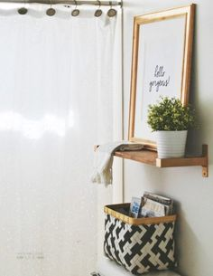 Little shelf with frame and plant for toilet room