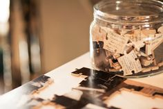 Puzzle pieces that your guests write on. Put together after the wedding and frame it.