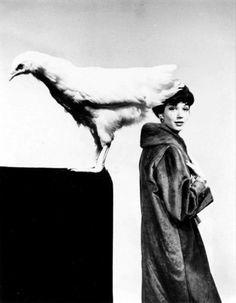 Simone modeling a coat by Balenciaga, 1959.
