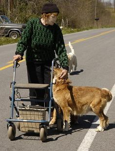 Venus Ramey, Miss America 1944, is shown with her dogs Tuesday, April 17, 2007, near her property in Waynesburg, Ky. Ramey, who was crowned Miss America in 1944 caught a man she thought was stealing from her farm in south-central Kentucky, she shot the tires out of his vehicle so he'd be stuck there until police came.