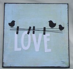 """Not a fan of """"love"""" on stuff but I like the idea of actually hanging things from clothespins on a wire attached to the wall...   """"Love"""" Wall Art with Birds on a Wire. $18.95, via Etsy."""