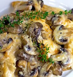 Mushroom Asiago Chicken-1 lb boneless skinless chicken breast (about 2 large) 2 cups mushrooms, cut in half 1 clove garlic, minced 3 springs fresh thyme 1 1/2 cups dry white wine 1/2 cup seasoned flour 2 tbs butter 2 tbs olive oil 1/2 cup heavy cream 1/4-1/2 cup shredded asiago cheese