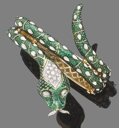An enamel and diamond hinged bangle  modelled as a snake.