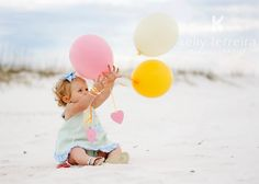 I had baby beach pictures in a little sailor outfit and so will my kids :) LOVE the added balloons, Family photo ideas