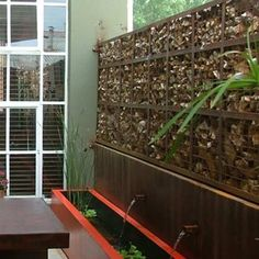 These gabion walls, metal baskets that are filled with stone, make the perfect modern garden wall. From Badec Bros Deco.