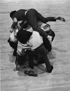 Simone Forti, 'Huddle', 1961.  In 'Huddle', dancers gather in a tightly packed group, then take turns climbing over the mass, forming a living sculpture that moves through the gallery.