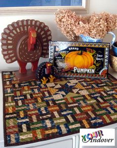 Congratulations to this week's winner of the Your Andover contest, Karen Martin! She made this festive tabletop quilt using various Jo Morton collections.