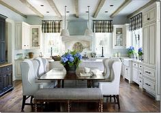 I am in love with this dining room. The wing-back chairs look so comfy and the whole atmosphere is just country chic!