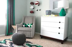 Modern Take on a Sport-Themed Nursery - love the gray modern glider and geometric pillow! #nursery
