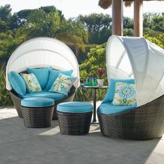 With its sun-blocking Sunbrella® privacy canopy and 360° swivel, this single-person daybed combines with the included ottoman to create the ideal spot for lounging, conversing or catching a quick afternoon siesta. | Frontgate: Live Beautifully Outdoors