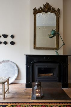 Fire place. #interior #design #industrial  Black surround fireplace mantel