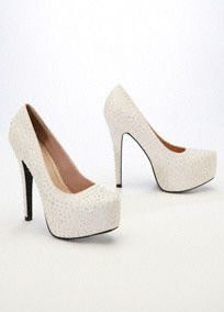 "Spruce up any outfit with these remarkable sparkling high heel pumps!  Features all over flatback crystals that are perfect for lighting up the night.  Available in Ivory-and it has a peachy tone.  5.5"" Heel. 1.5"" Platform.  Imported."