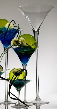 "Very Tall 27.5""  Glass Martini Vases $78 each (top is 12"" wide)  http://www.save-on-crafts.com/latticejars.html"
